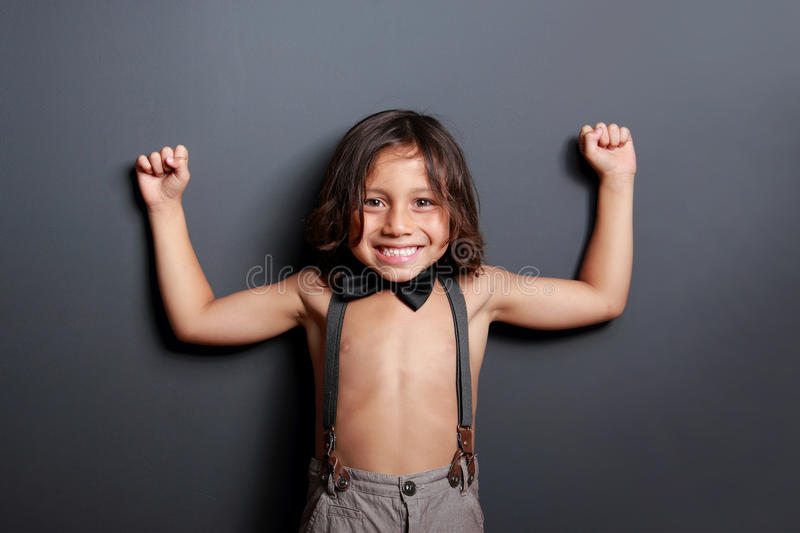Cheerful cute little boy posing and smiling royalty free stock image