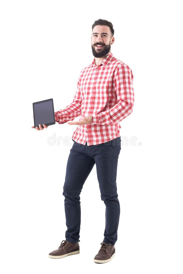 Cheerful delighted laughing business man holding and showing blank tablet screen stock photo