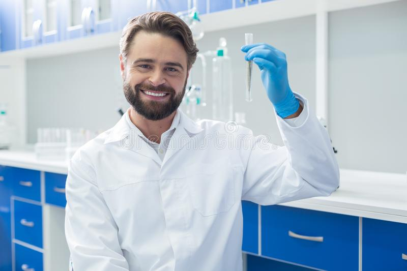 Cheerful delighted man being happy about his success stock photo