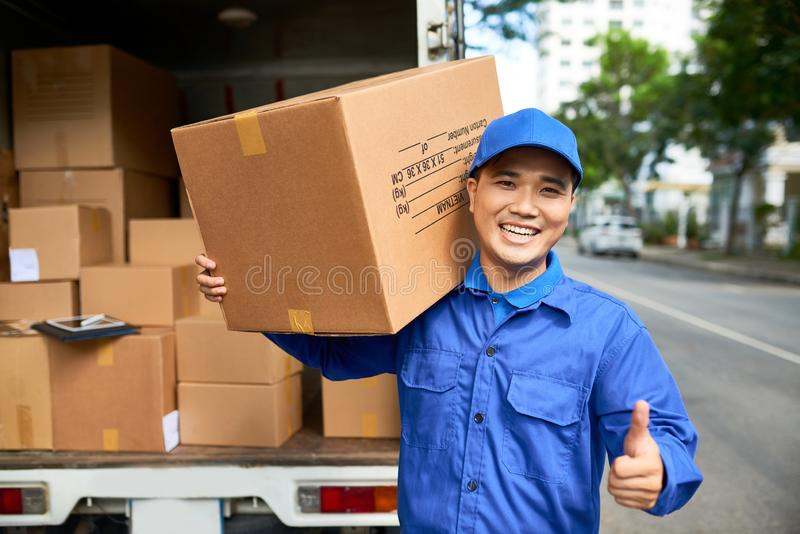 Cheerful delivery man royalty free stock image