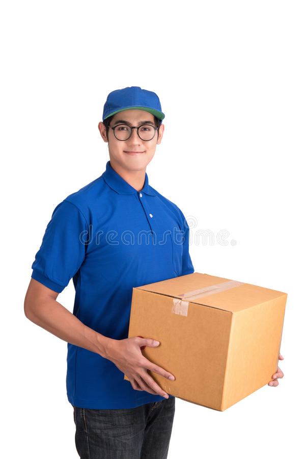 Cheerful delivery man. Happy young courier holding a cardboard box. And smiling while standing isolated with clipping path royalty free stock image