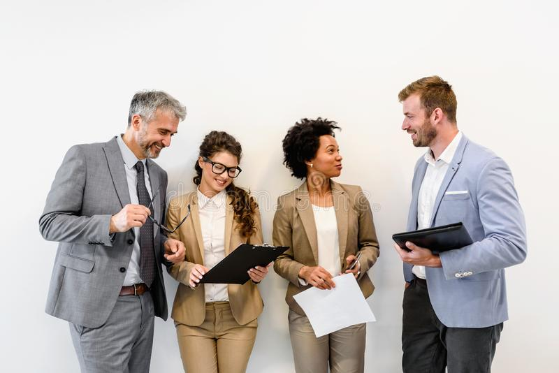 Cheerful diverse business team discussing work royalty free stock photo