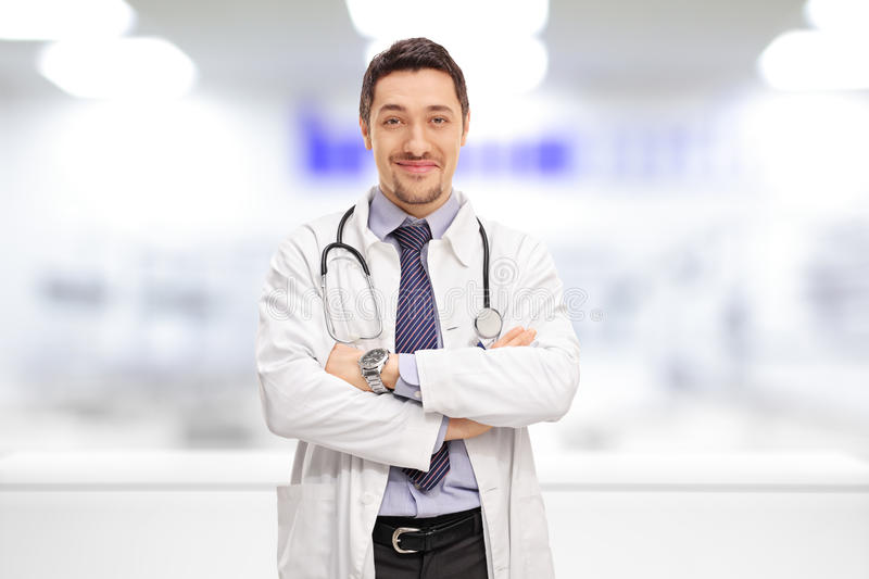 Cheerful doctor standing in a hospital room royalty free stock photo