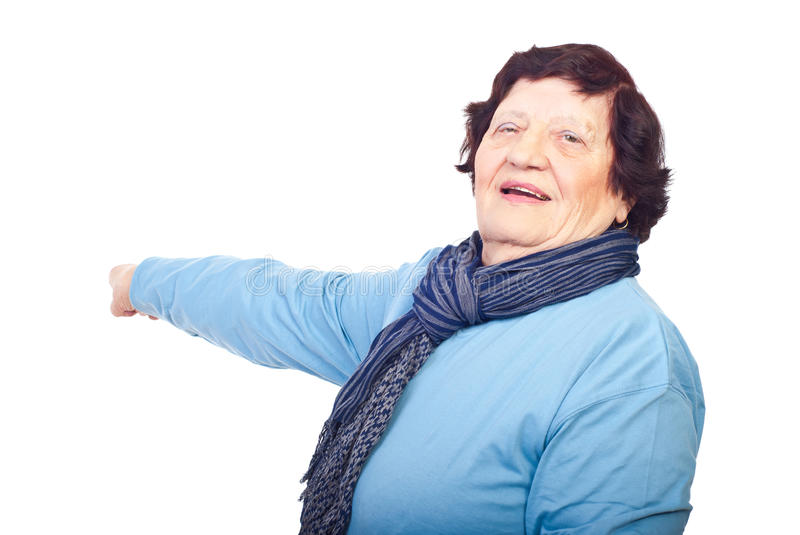 Download Cheerful Elderly Woman Pointing To Copy Space Stock Photo - Image: 16552600