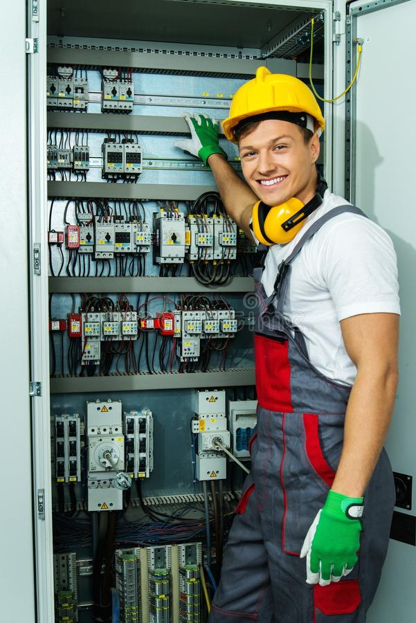 Cheerful electrician on a factory royalty free stock photography