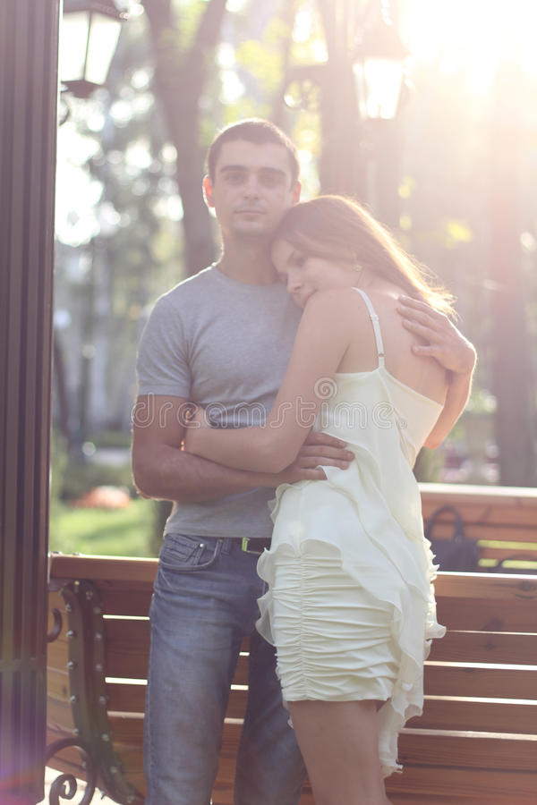 Download Cheerful Embraced Couple Near Bench Stock Photo - Image: 26617482