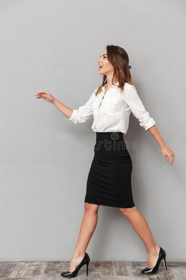 Cheerful emotional business woman walking isolated royalty free stock images