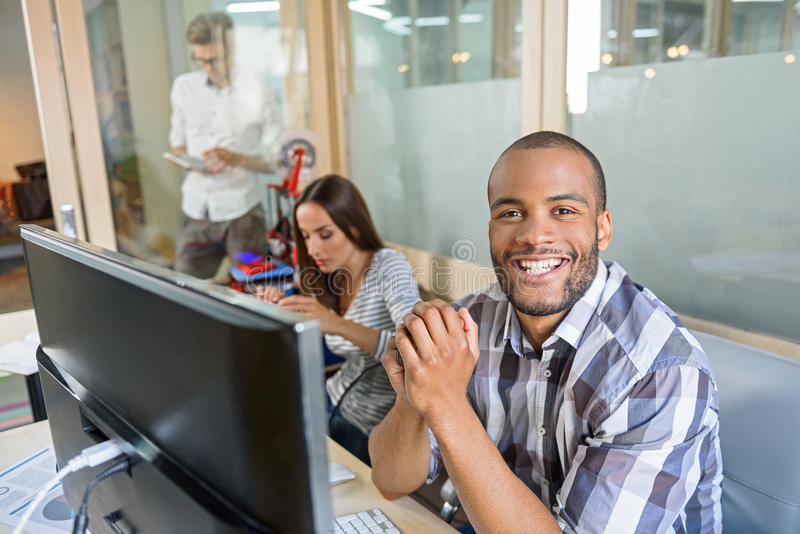 Cheerful engineers are entertaining with 3d printer royalty free stock image