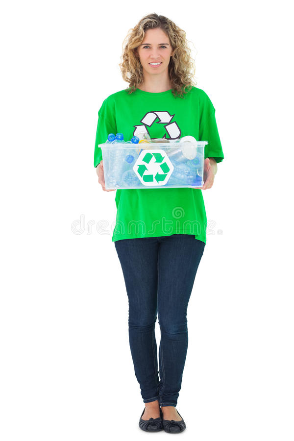 Cheerful environmental activist holding recycling box royalty free stock photography