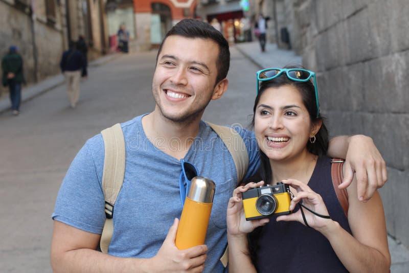 Cheerful ethnic couple enjoying a vacation royalty free stock photos