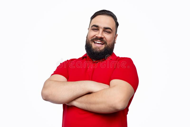 Cheerful ethnic male with folded arms royalty free stock image