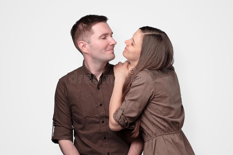 Cheerful european young couple in brown clothes stock photo