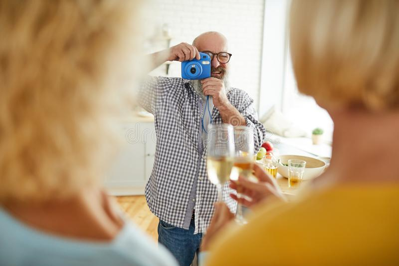 Cheerful man taking photo of friends stock photos