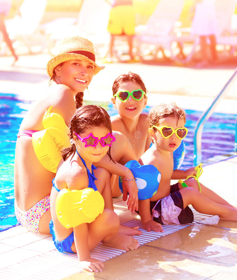 Cheerful family on beach resort. Big cheerful family having fun on beach resort, active lifestyle, spending time together near poolside, summer vacation and royalty free stock images