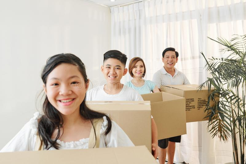 Cheerful family with cardboard boxes stock photo