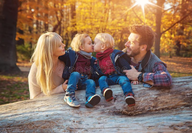 Family enjoying an autumn weather in a forest stock images