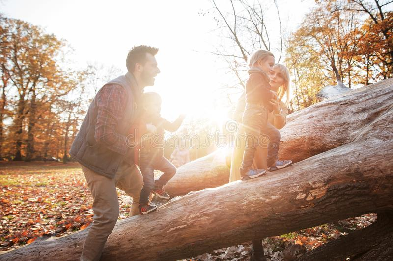 Cheerful family enjoying great, autumnal weather stock images
