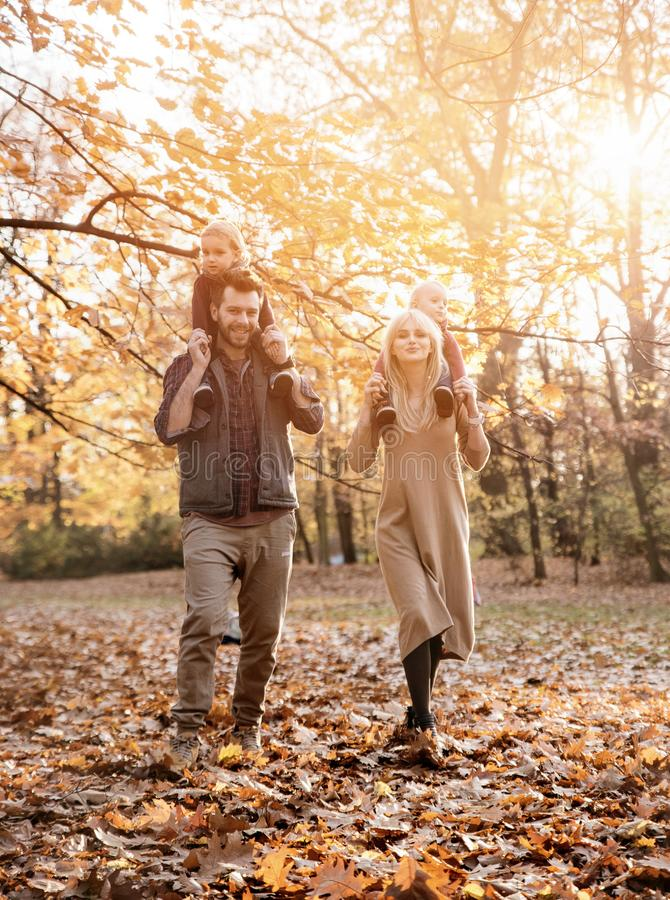 Joyful family enjoying great, autumnal weather royalty free stock photos