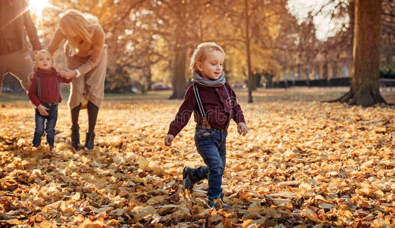 Joyful family enjoying great, autumnal weather royalty free stock images