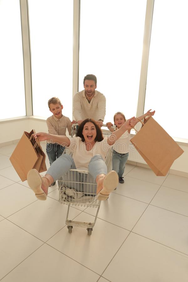 Cheerful family goes shopping in a hypermarket stock photo