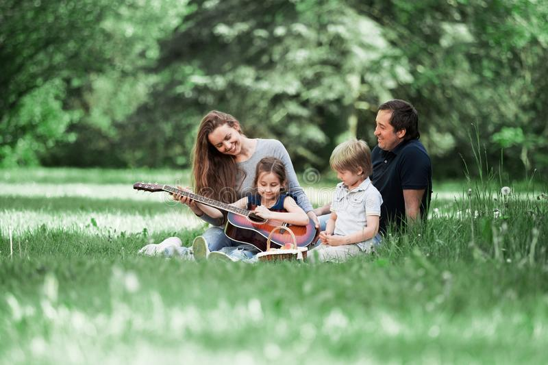 Riendly, cheerful family having a picnic in the park stock photos