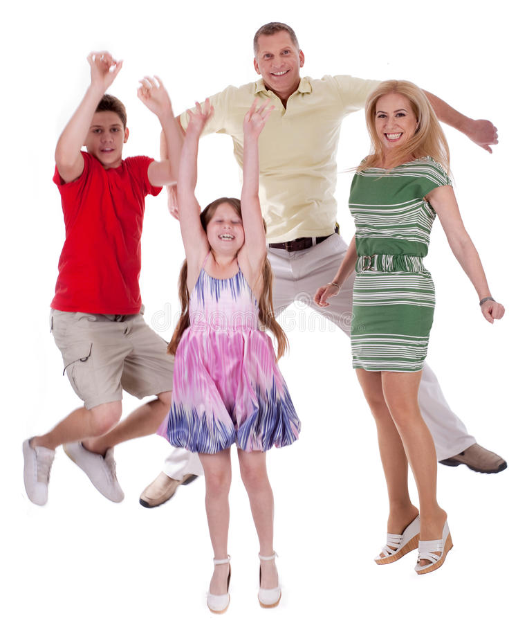 Cheerful family jumping to the air and having fun stock photo