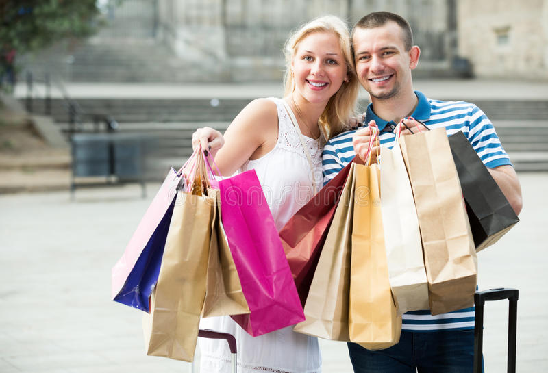 Cheerful family looking satisfied after shopping royalty free stock photo