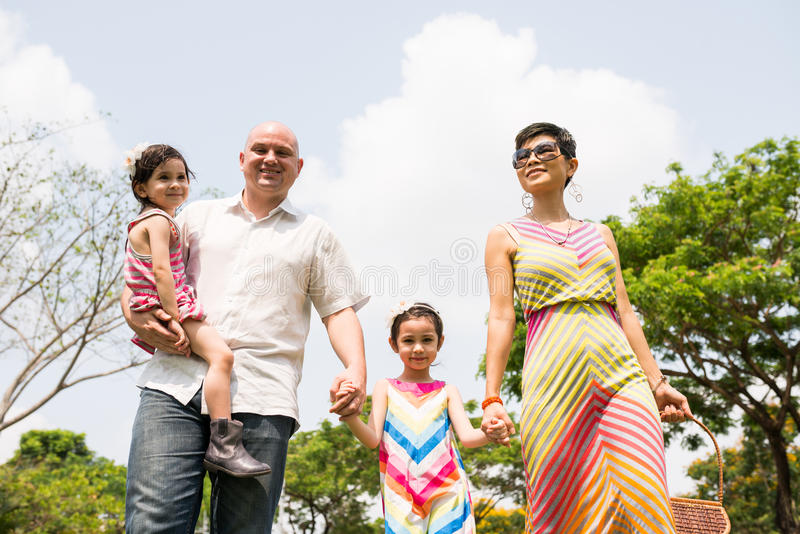 Cheerful family outdoors stock image
