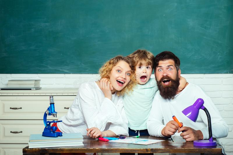 Cheerful family playing with set for creativity. School kids. First day at school. Pupil learning letters and numbers - royalty free stock images
