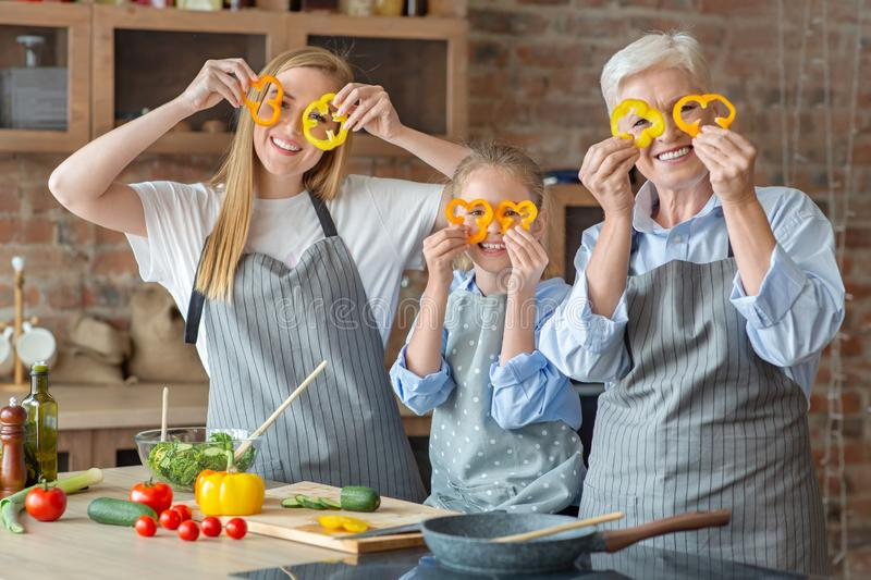 Cheerful family spending good time together while cooking royalty free stock photography