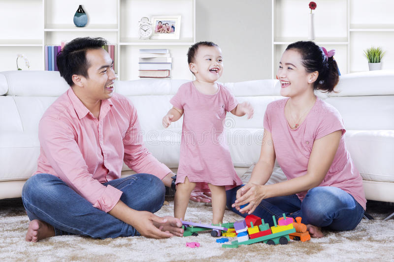 Cheerful Family With Toys In The Living Room Stock Photo - Image of ...