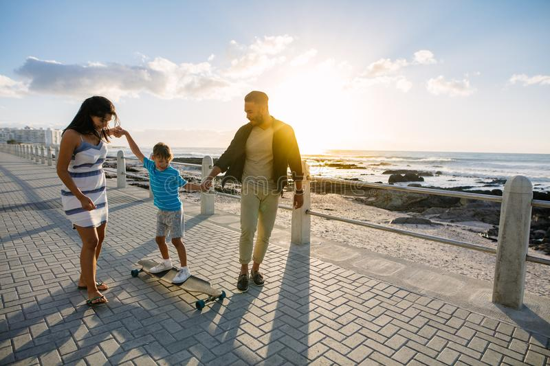 Family on a day out near the sea stock image