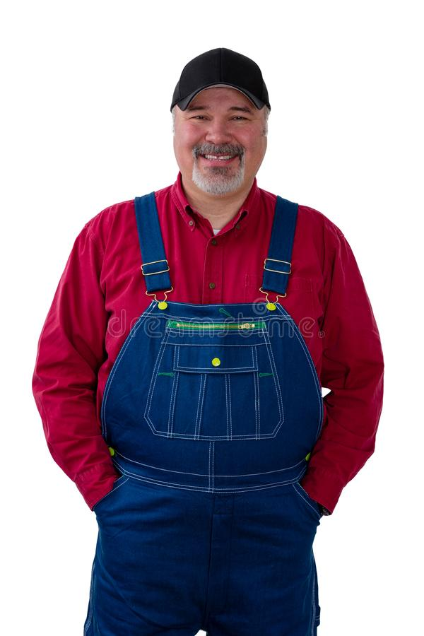 Portrait of happy man wearing dungarees royalty free stock photography