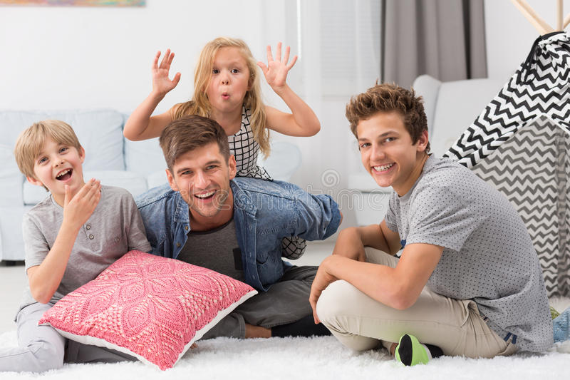 Cheerful father with children stock image