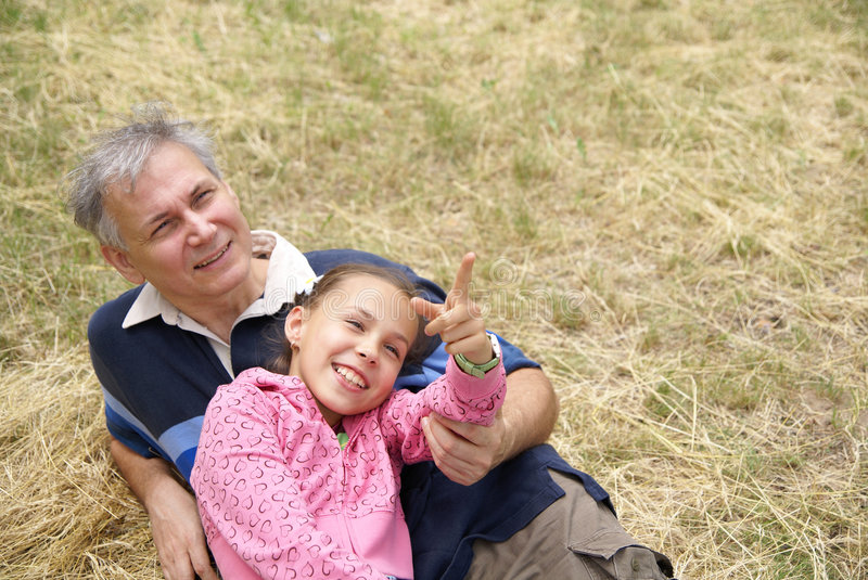 Cheerful father and daughter stock images