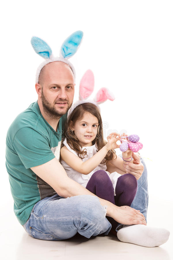 Cheerful father and daughter with bunny ears stock photography