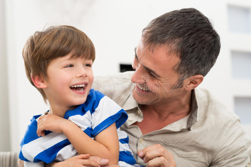 Cheerful Father And Son. Happy Father And Son Playing With Each Other