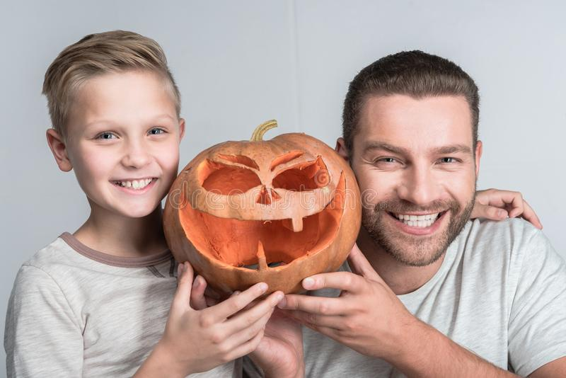 Father and son with halloween pumpkin royalty free stock photo