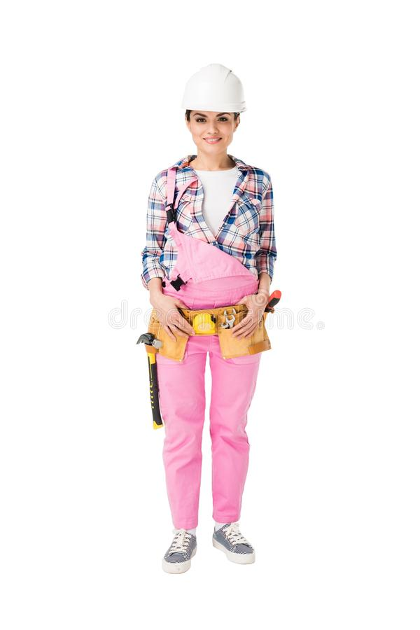 Cheerful female construction worker in pink uniform royalty free stock image