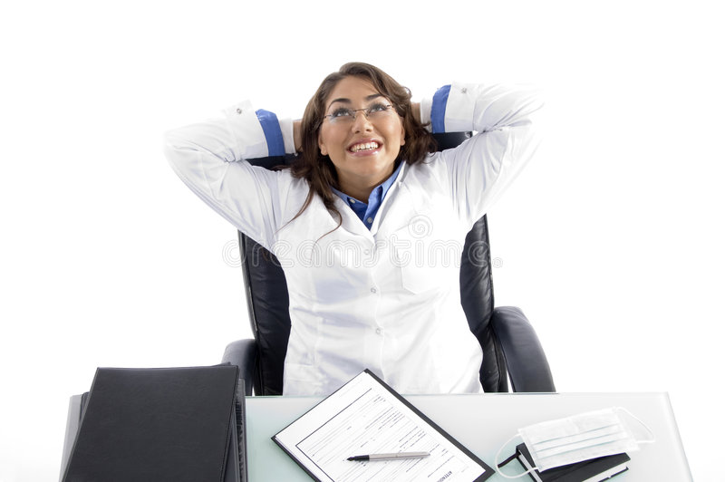Cheerful female doctor looking upward. Against white background royalty free stock images