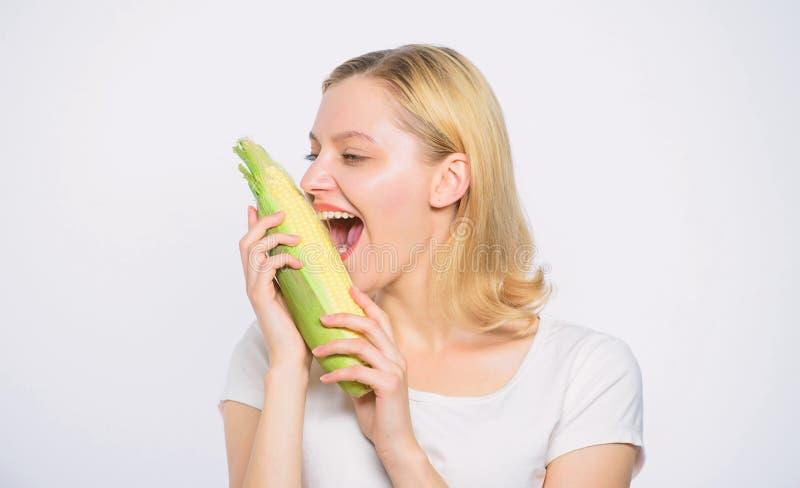 Cheerful female farmer. Farming, farmer girl with maize. corn crop. vitamin dieting food. healthy teeth. hunger stock images