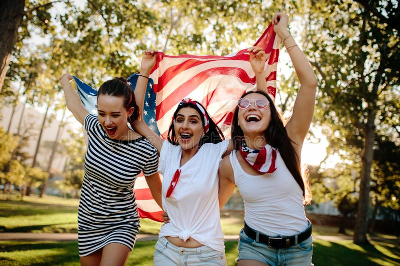 Enthusiastic American girls celebrating independence day stock photo