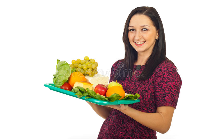 Cheerful female hold plateau with healthy food royalty free stock image