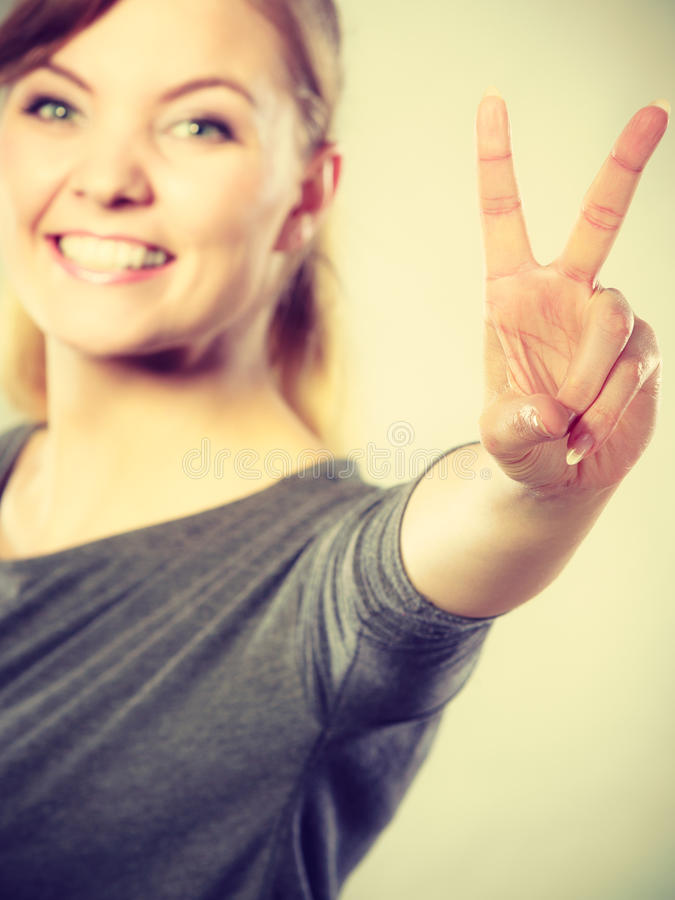 Cheerful female shows victory symbol. Good feeling and positive emotions of win. Cheerful happy female shows two fingers as symbol of victory and won stock images