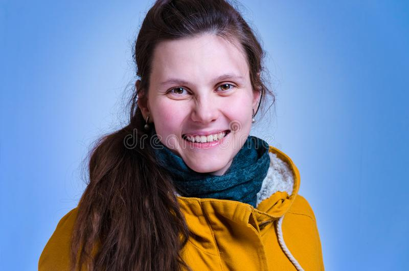 Cheerful, feminine woman smile in yellow, jacket. close up portrait of pretty caucasian young girl. cute brown haired stock photography