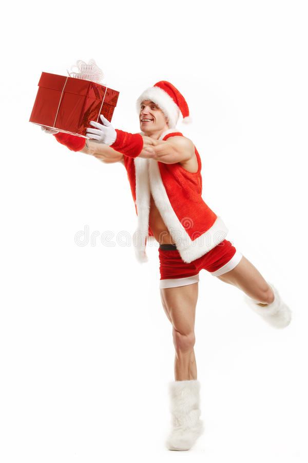 Cheerful fitness Santa Claus holding a red box stock photo