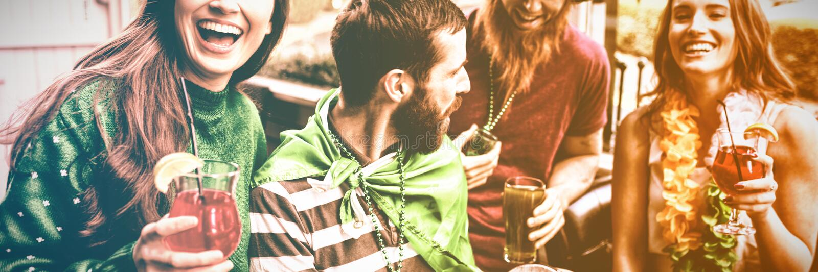 Cheerful friends celebrating St Patricks day. With drinks stock images