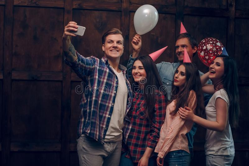 Best friends doing selfie in birthday party stock images