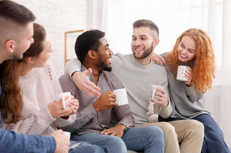 Cheerful friends drinking coffee and enjoying their company stock photos