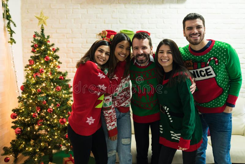 Cheerful Friends Enjoying Christmas Together At Home stock photos